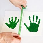 Mail Grandma these Leprechaun Handprints Cards free printable at PagingSupermom.com #stpatricksday #leprechaun #kidscraft