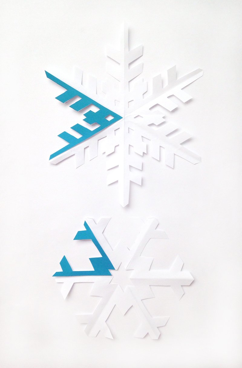How to Cut Out a Snowflake - get free paper snowflakes templates at PagingSupermom.com