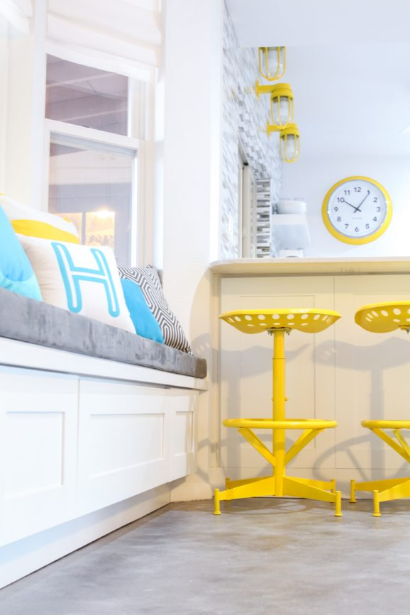 Love this window seat and those yellow tractor stools!