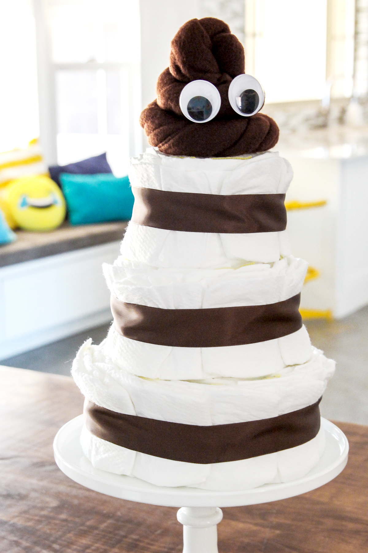LOL! How cute is this Poo Emoji Diaper Cake for an Emoji themed Baby Shower via @PagingSupermom