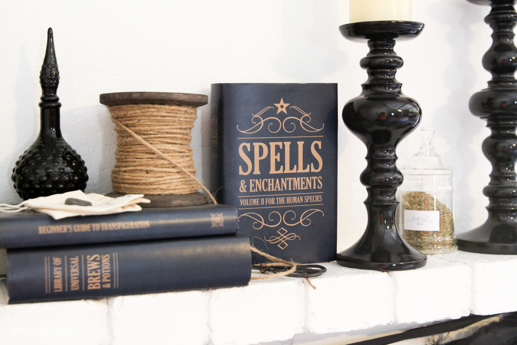 Witch Party Ideas: Free printable Spell Book covers are perfect for this Witchy Mantle Decor via @PagingSupermom