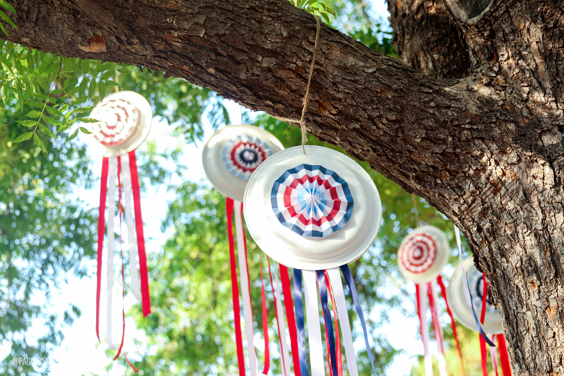 Tutorial and FREE templates to make these cute Paper Plate Pinwheels for the Fourth of July from @PagingSupermom