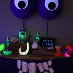 Love this TOMATOA TABLE - for a Moana Tomatoa Party - Blacklight Shiny Party based on the Realm of Monsters in Moana movie via @PagingSupermom