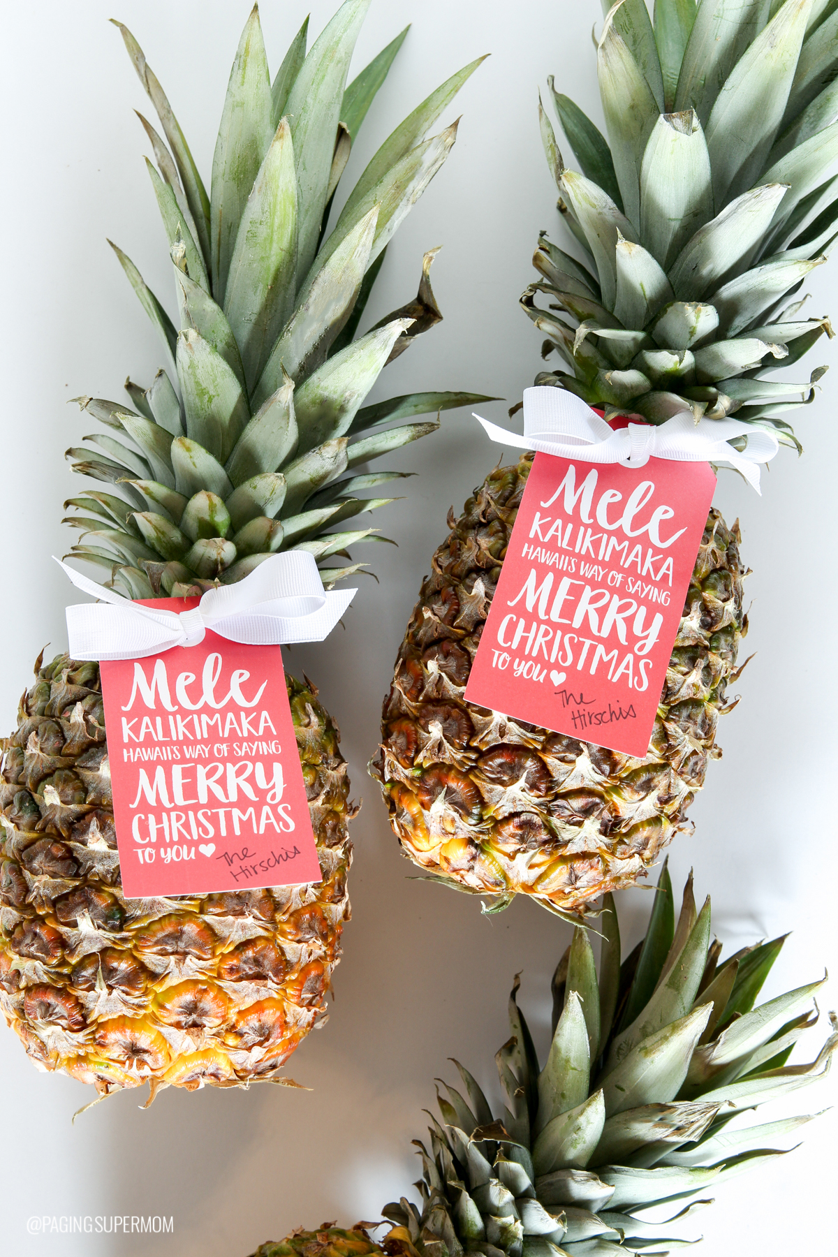 Give Christmas Pineapples with FREE Mele Kalikimaka Gift Tag via @PagingSupermom