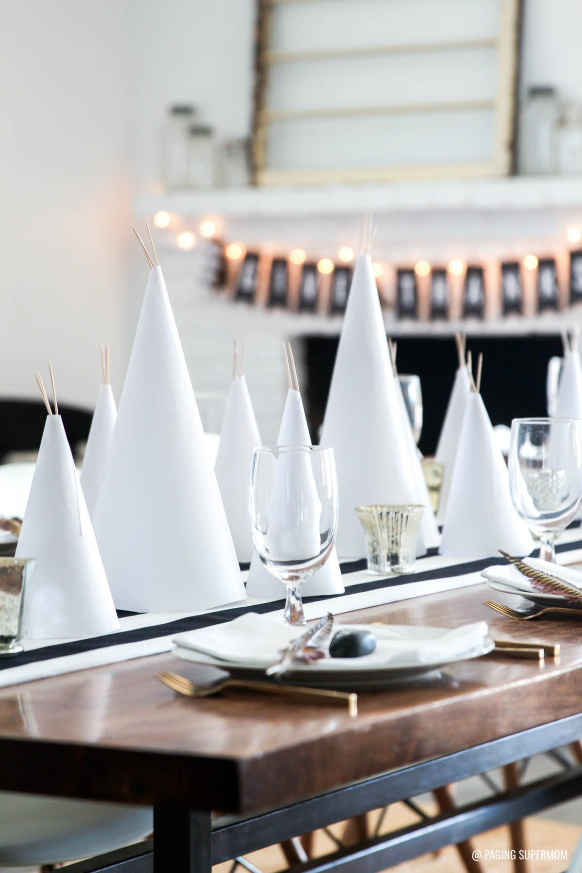 """Simple Thanksgiving Table Ideas - love the easy paper teepees and FREE printable """"Give Thanks"""" banner from @PagingSupermom"""