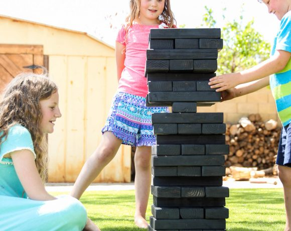 Kids Playing Giant Jenga-inspired Stacking Blocks - DIY Backyard Games plans from @HomeDepot via @PagingSupermom