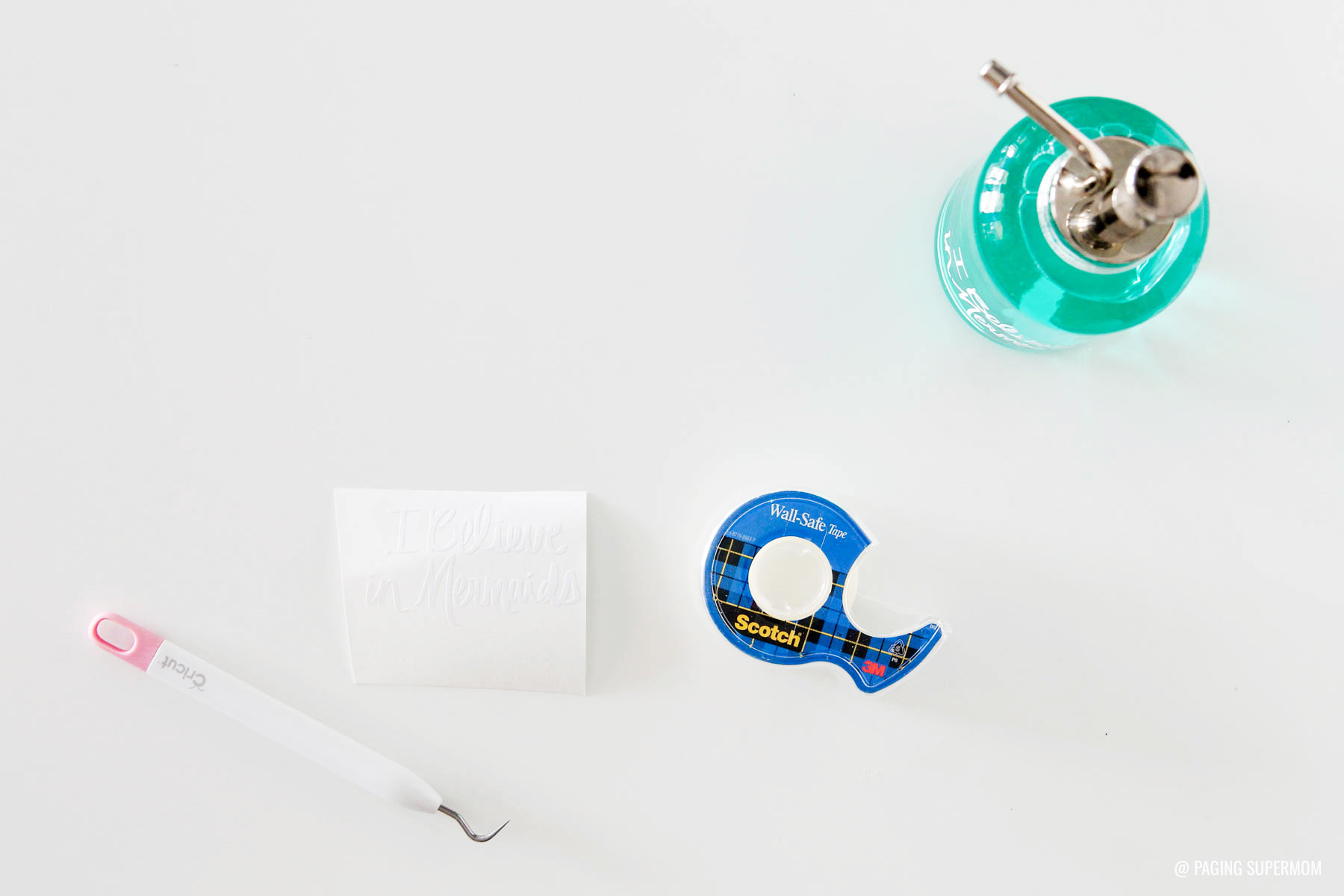Cricut Vinyl Mermaids Soap Dispenser Tutorial via @PagingSupermom