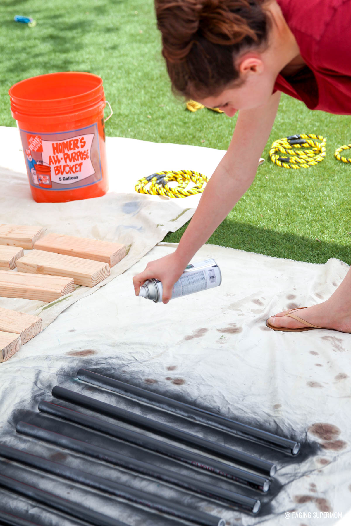 Spray Painting Pipe for a Ring Toss Backyard Games from @HomeDepot via @PagingSupermom